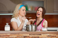 Young girls try soup in the kitchen - PhotoDune Item for Sale