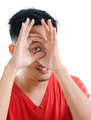 Asian man peeping through fingers hole - PhotoDune Item for Sale