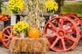 pumpkins next to an old farm tractor - PhotoDune Item for Sale