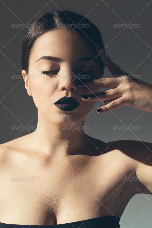 Fashionable attractive woman with black lipstick - Stock Photo - Images