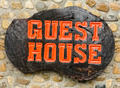 Old retro wood sign with the text Guest house. - PhotoDune Item for Sale