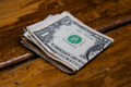 Wad of Cash on Wooden Bar - PhotoDune Item for Sale