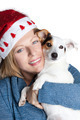 Woman with christmas hat hugging her jack russell - PhotoDune Item for Sale