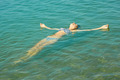 Teen girl lying on the sea water surface - PhotoDune Item for Sale