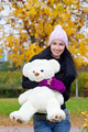 happy young woman with a teddy bear - PhotoDune Item for Sale