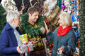 Parents Looking At Son With Wreath Around Neck In Store - PhotoDune Item for Sale