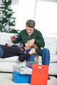 Man Covering Woman's Eyes While Holding Christmas Gift - PhotoDune Item for Sale