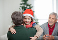 Happy Boy Embracing Father During Christmas - PhotoDune Item for Sale