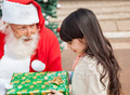 Girl Taking Christmas Gift From Santa Claus - PhotoDune Item for Sale