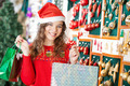 Woman In Santa Hat Carrying Shopping Bags - PhotoDune Item for Sale