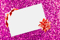 Christmas sheet of paper with bow on pink defocused background - PhotoDune Item for Sale