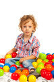 Toddler boy sitting on colorful balls - PhotoDune Item for Sale