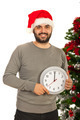 Cheerful Christmas man holding clock - PhotoDune Item for Sale