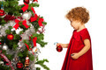 Toddler girl decorate tree - PhotoDune Item for Sale