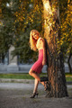 woman leaned against a birch tree. - PhotoDune Item for Sale
