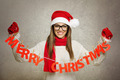 Beautiful young Santa girl with Merry Christmas text decoration - PhotoDune Item for Sale