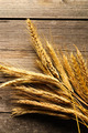 Rye spikelets over wooden background - PhotoDune Item for Sale