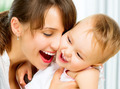 Happy Smiling Mother and Baby kissing and hugging at Home - PhotoDune Item for Sale