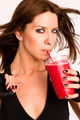 Attractive Athletic Female Expressing Positively Holds Frozen Fruit Drink - PhotoDune Item for Sale