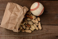 Baseball and a Bag With Peanuts Spilling Out - PhotoDune Item for Sale
