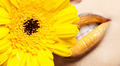 Close-up of yellow woman's lips with yellow flower - PhotoDune Item for Sale
