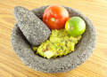 Molcajete Mortar Bowl and Pestle Filled With Guacamole And Ingredients - PhotoDune Item for Sale