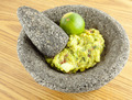 Molcajete Mortar And Pestle Bowl Filled With Guacamole And A Lime - PhotoDune Item for Sale