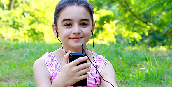 VideoHive Girl Listening to Music on a Smartphone 1 6101455