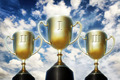 Three trophy cups against cloudy sky - PhotoDune Item for Sale