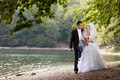Newly Married Couple by the Lake - PhotoDune Item for Sale