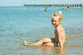 Little girl on the coastal seawater - PhotoDune Item for Sale