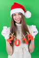 Happy teenage girl showing New Year number sign - PhotoDune Item for Sale