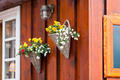 Flowers in wicker pots on a icelandic wooden house - PhotoDune Item for Sale