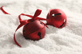 Red Christmas bells with ribbon in snow - PhotoDune Item for Sale