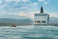 Pilot boat following luxury cruise ship - PhotoDune Item for Sale