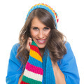 Beautiful young woman wearing colorful winter hat and scarf smiling - PhotoDune Item for Sale