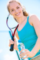 Pretty sportswoman with racket on shoulders - PhotoDune Item for Sale