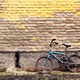Old rusty vintage bicycle leaning against a brick wall - PhotoDune Item for Sale