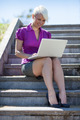 Gorgeous blonde businesswoman is working outside with her comput - PhotoDune Item for Sale