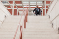 Businessman on wheelchair in front of stairs - PhotoDune Item for Sale