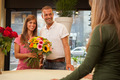 Happy smiling couple at the flower shopt with a bunch of flowers - PhotoDune Item for Sale