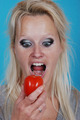 Blond womanl eating a tomato - PhotoDune Item for Sale