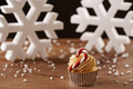 Candy bar cupcake on Christmas background - PhotoDune Item for Sale
