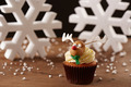 Rudolph reindeer cupcake on Christmas background - PhotoDune Item for Sale