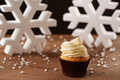 White chocolate cupcake on Christmas background - PhotoDune Item for Sale