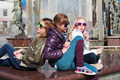 Teenage girls relaxing against a city fountain - PhotoDune Item for Sale