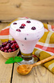 Yogurt thick with cranberries and spoon on the board - PhotoDune Item for Sale