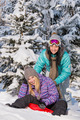 Two teenage friends enjoy winter snow bobsleigh - PhotoDune Item for Sale