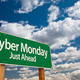 Cyber Monday Just Ahead Green Road Sign with Dramatic Clouds and Sky. - PhotoDune Item for Sale