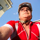 Mature Man Rides Bicycle Downtown Seen from Low Angle - PhotoDune Item for Sale